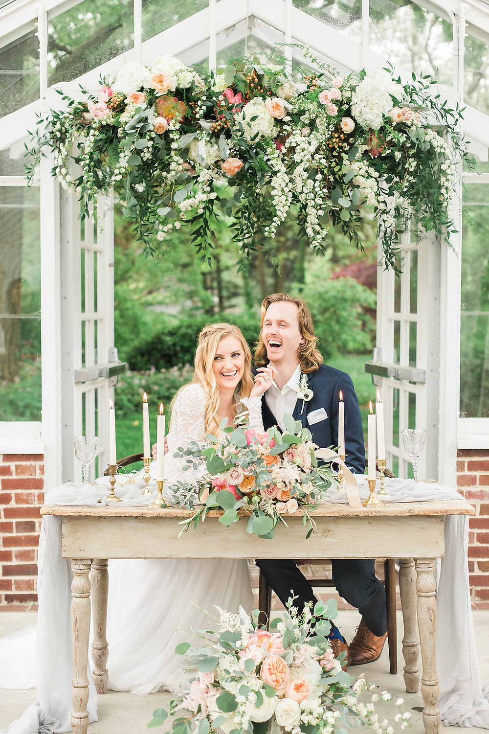 Garden arch is the focal point in the mansion greenhouse, for a tiny, elopement wedding reception