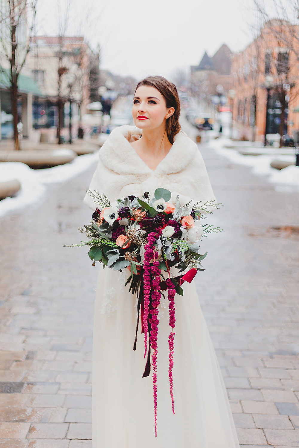Wintry wonderland photo of bride in streetside photo. Photo credit: Kayla Dutcher Photography