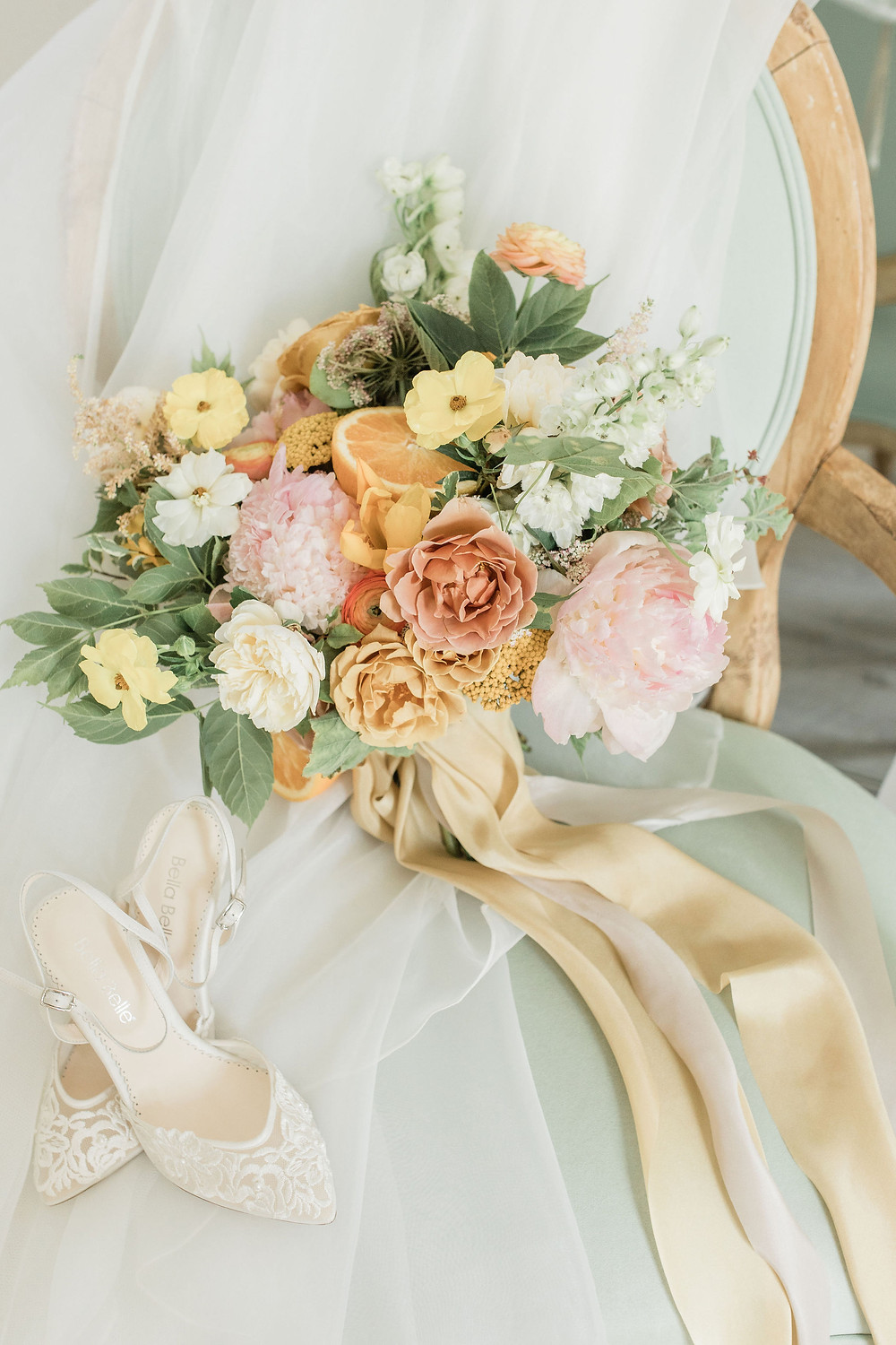 Flowers on chairs, draped with the bridal veil!  Couldn't be more beautiful with our Pistachio green French farmhouse chair.