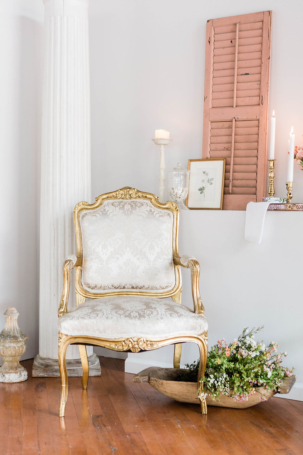 French vintage Platinum covered, gold-trimmed armchair with vintage finds create an inspiring room
