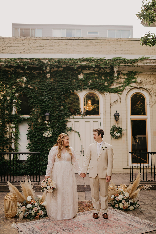 The happy couple on wedding day at vintage Villa Filomena, Milwaukee, WI