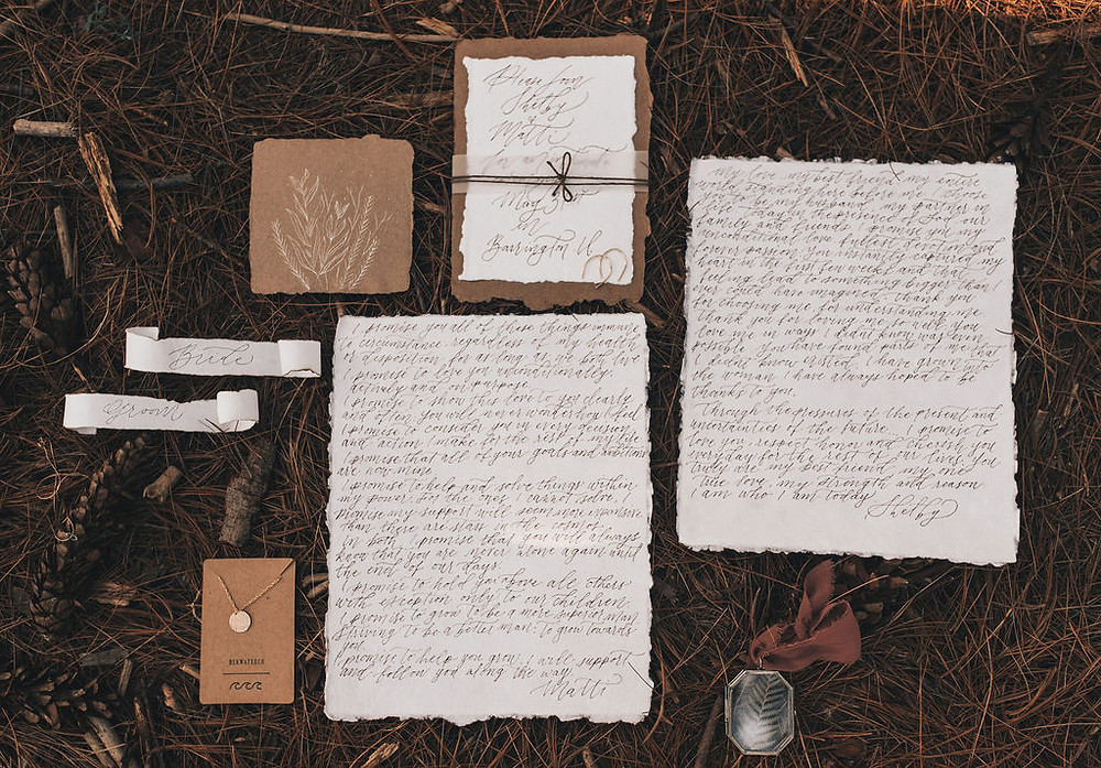 wedding vows displayed on the forest floor