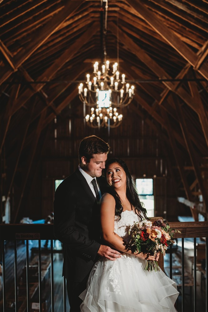 the barn loft decorated with chandeliers is the perfect background for photos