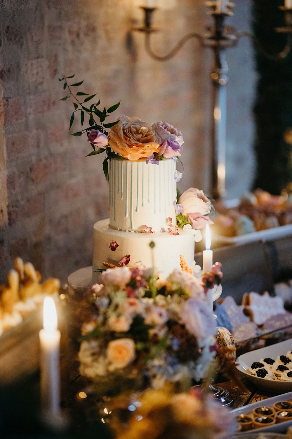 beautiful cake on a sweets table filled with vintage details