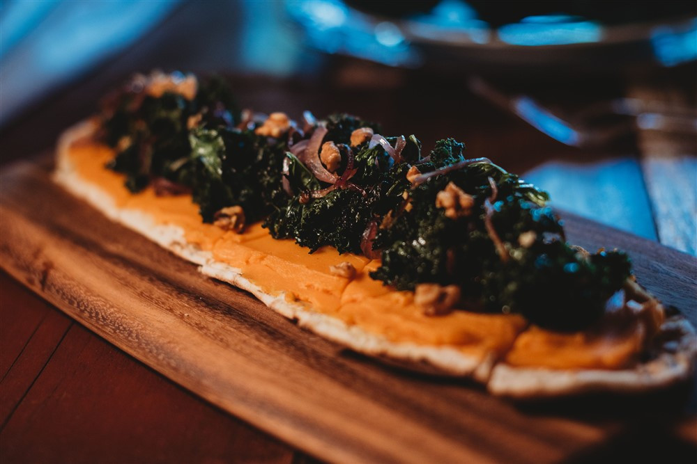 appetizers served on wooden boards for barn wedding reception