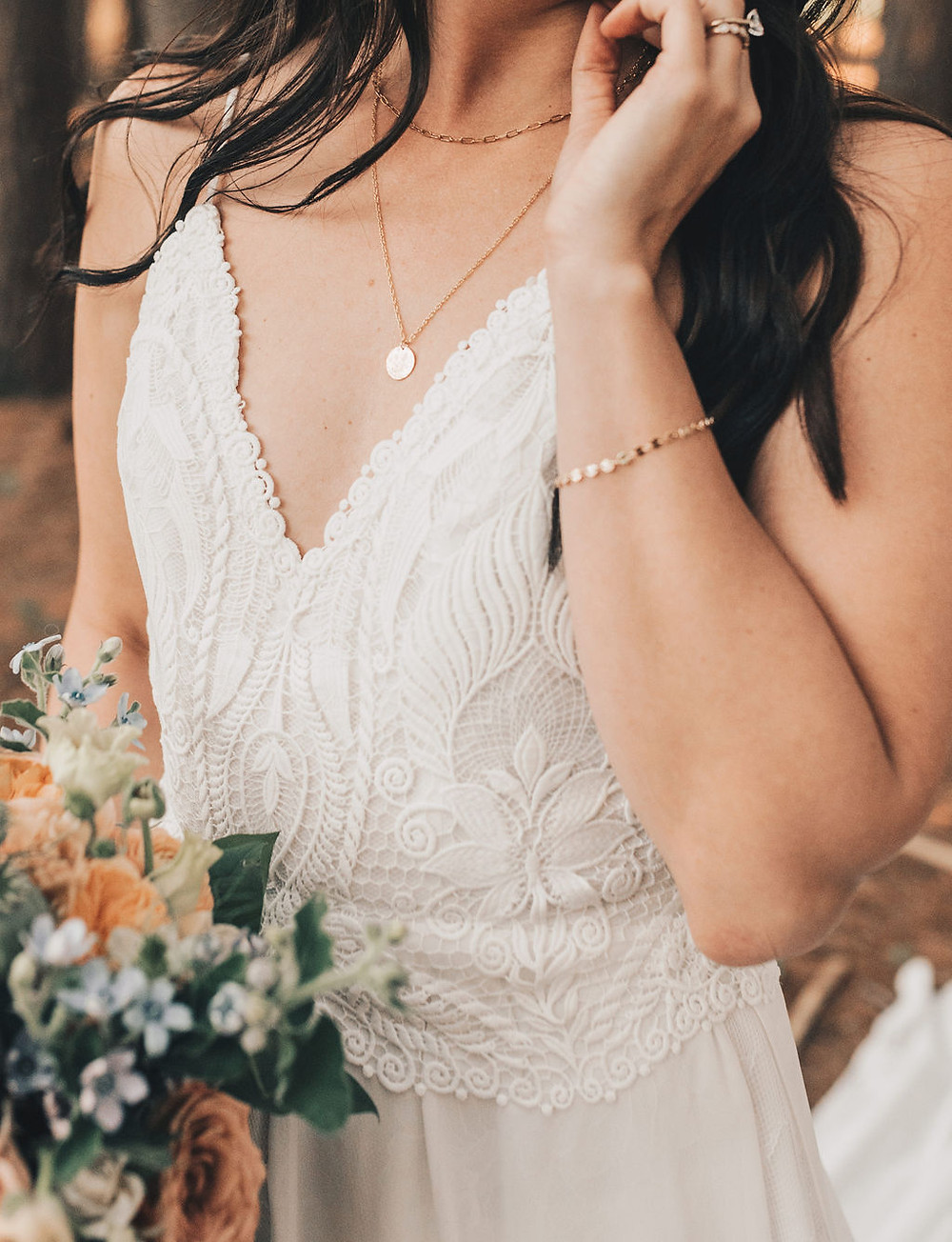 Custom jewelry added a simple touch to the bride's look.