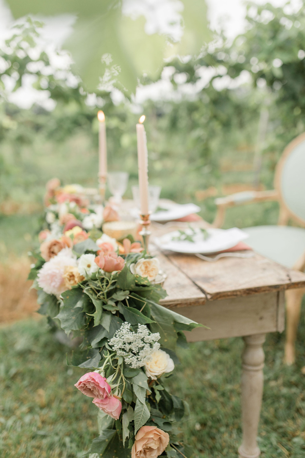 Vintage sweetheart table made from reclaimed wood is a perfect way to create a private seating area for the couple on wedding day!