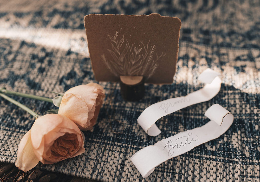 wedding details, flowers, and invitation display