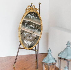 Oval gold gilt mirror with ribbon decoration