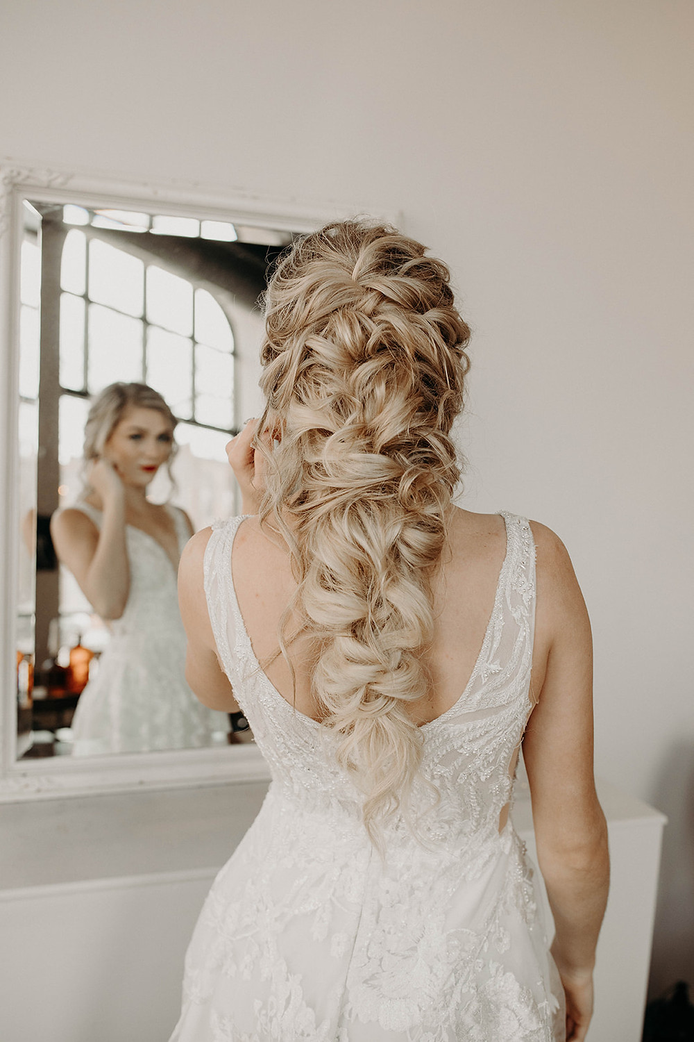 Bride's beautiful, loose braid fits the boho-style of this elopement wedding