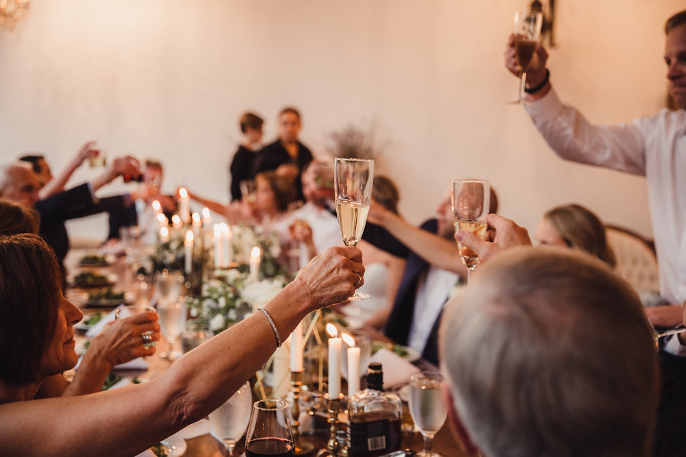 Cheers to the new couple as they celebrate with champagne toast