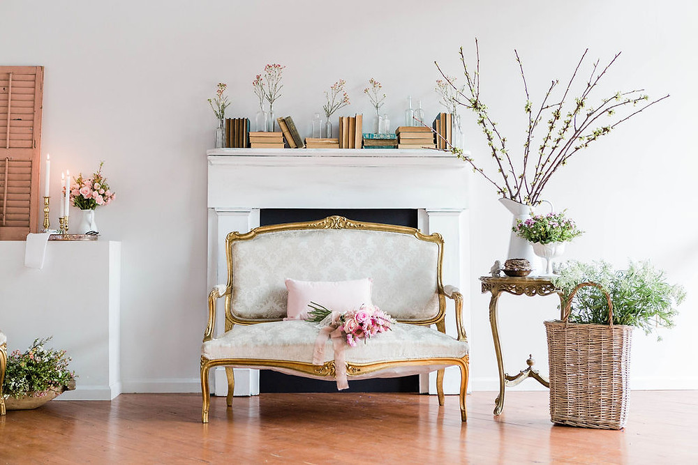 Platinum settee styled in French-inspired vignette