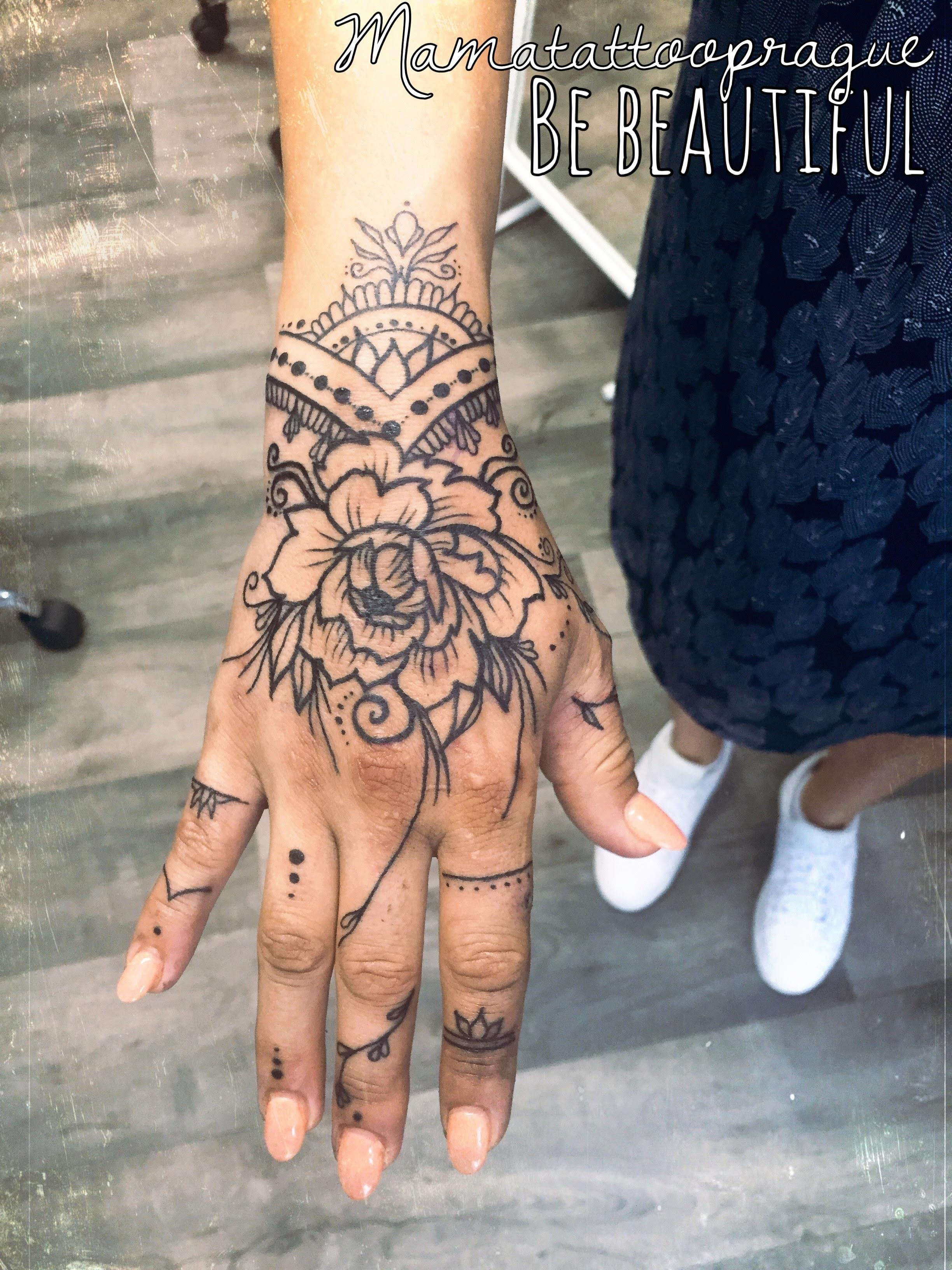mandala hand tattoo
