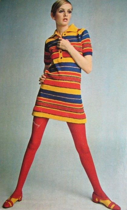 Twiggy dresses in a colourful striped mod dress, orange tights and flat shoes in the 1960s.