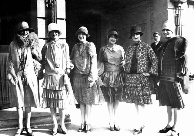 Black and white photograph of six women dressed in the high fashion of the 1920s