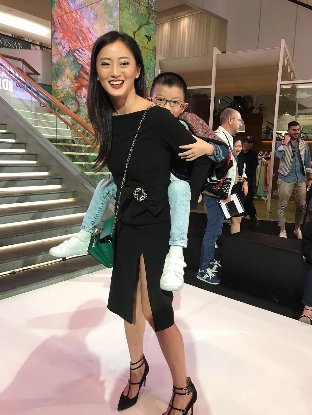 Charina (wearing Betty Tran) with her son Keagan