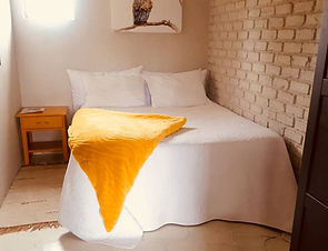 Yellow Stable White Bed.jpg
