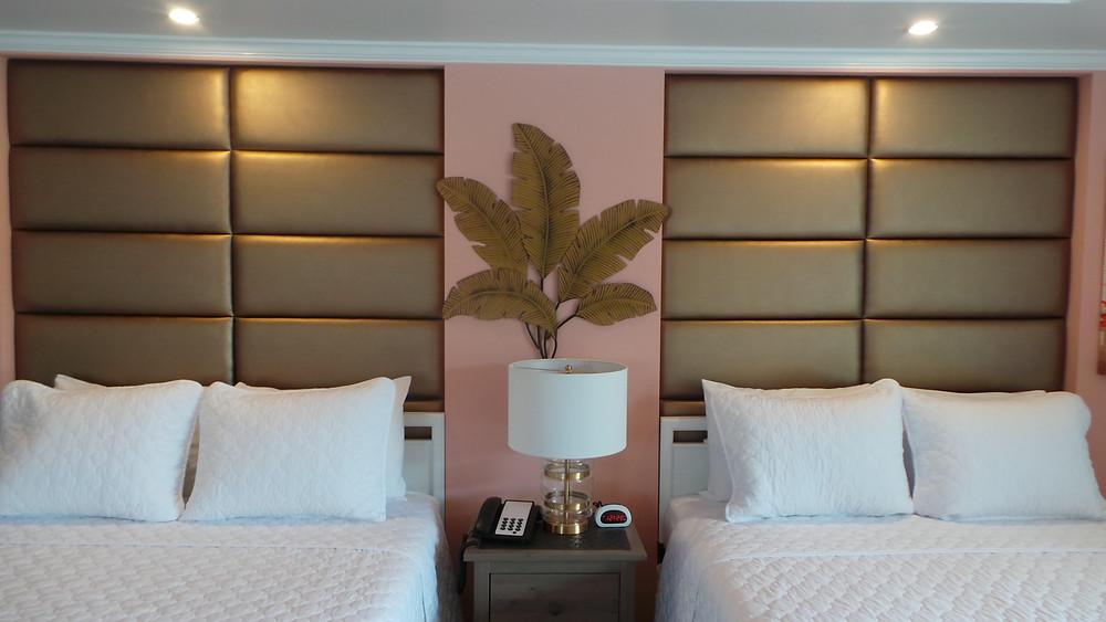 Studio room showcasing paneled headboards over 2 queen beds