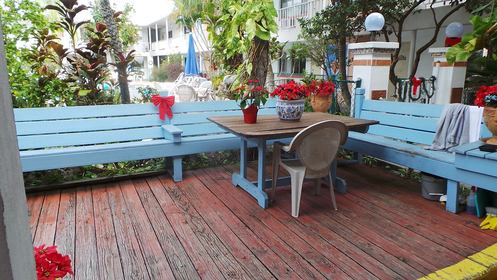 photo of blue built in benches and table and old deck