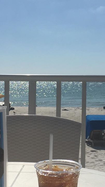 Photo of a the view (sand and water) while sitting at a table at Mango's Tiki Bar across the street at the DoubleTree.