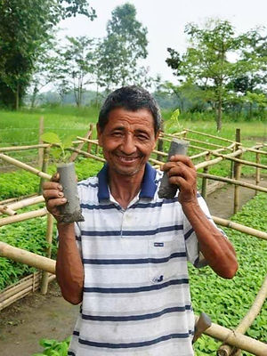 Nepal_2015_Man%20in%20nursery%20holding%