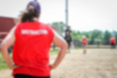 Instructor, Meg, watches while a camper trots their pony