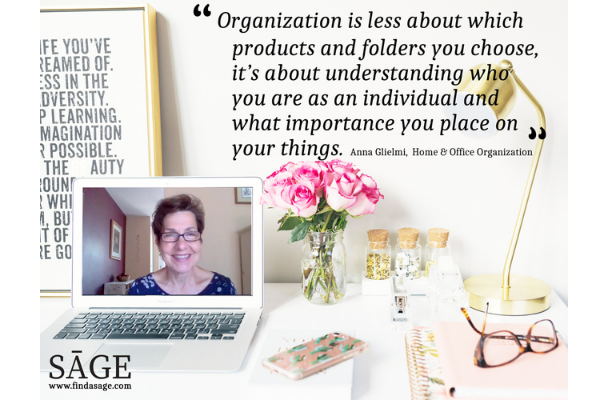 A woman on a laptop screen with a vase of flowers below a long quote