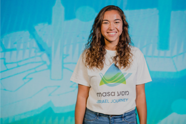 A smiling female wearing a Masa program t-shirt