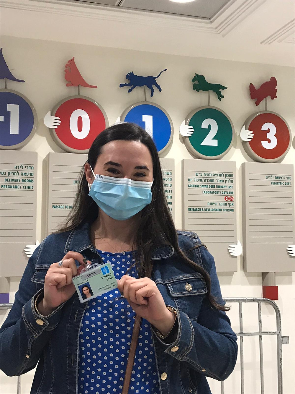 Talia Kupferman holding her ID card for Hadassah Ein Karem Hospital in Jerusalem - nefesh b nefesh