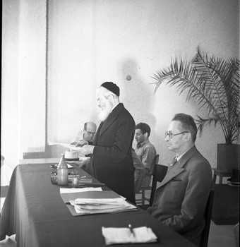 Yitzhak Ben Tzvi sitting at a table with two other men at the Fourth Electoral Assembly