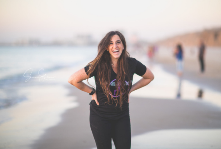 Esther Taub of Esther Taub Fitness standing at the beach