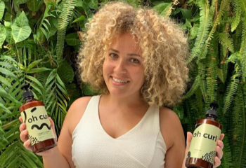 Oleh Breanna Stein holding her product, Oh Curl