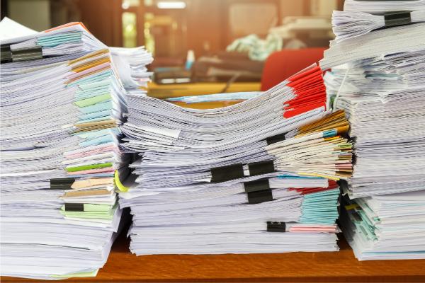 Stacks of folders on a desk