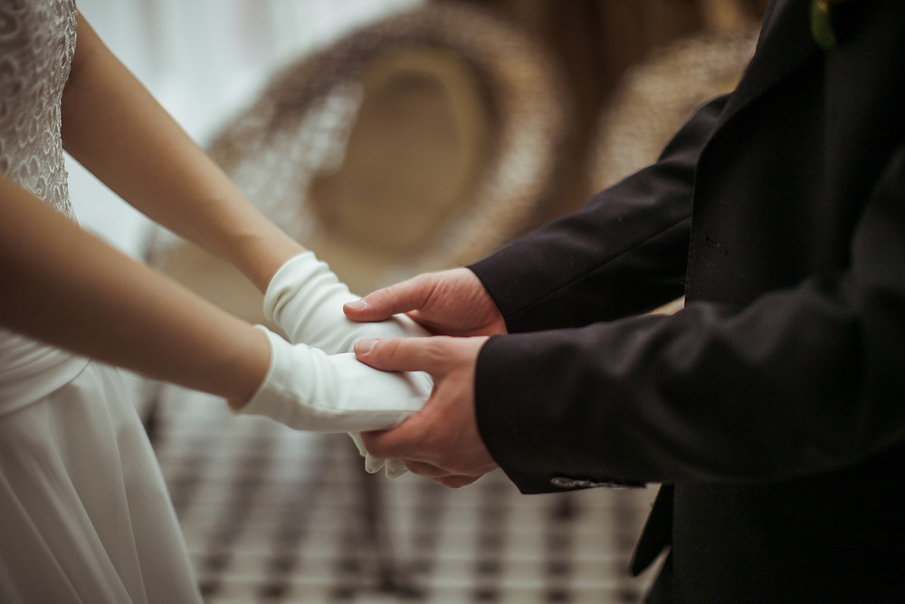 A man and woman holding hands