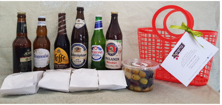 An unpacked beer basket with nut packets on a table by Love from the Shuk