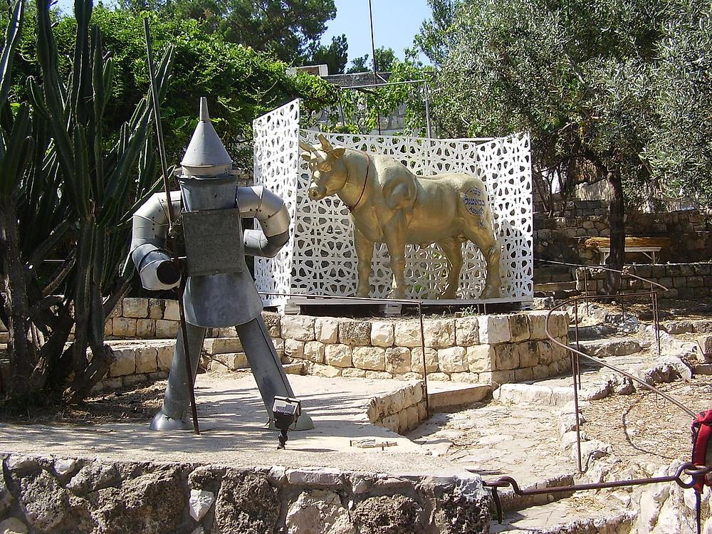 Sculptures of a golden calf and Tin Man in Ein Hod