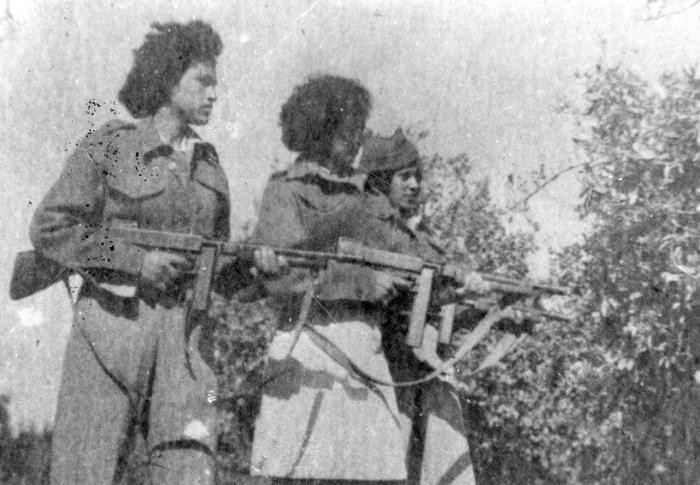 Black and white photograph of three female Lehi fighters holding guns