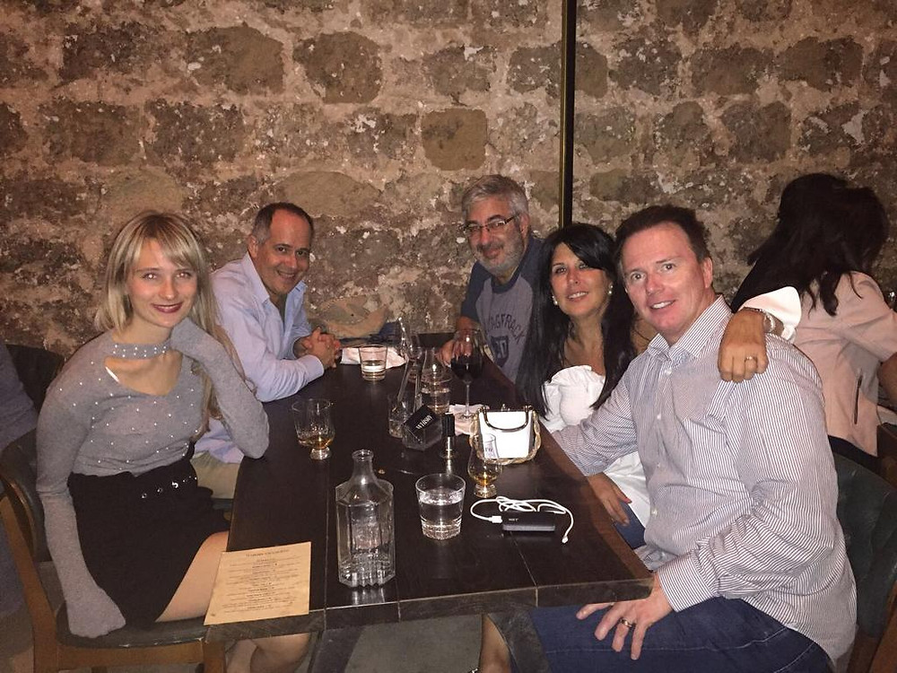 Eedie and Mark Fitzsimmons at a restaurant table with two male friends and one female friend