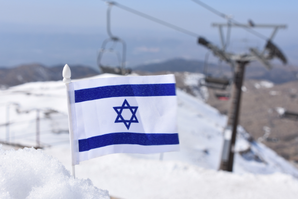 An Israeli flag in a pile of snow on Mount Hermon after a snowstorm