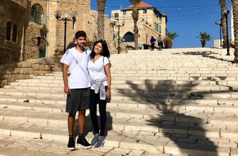 Oleh Kevin & Eddna Samuel standing on steps in Jaffa