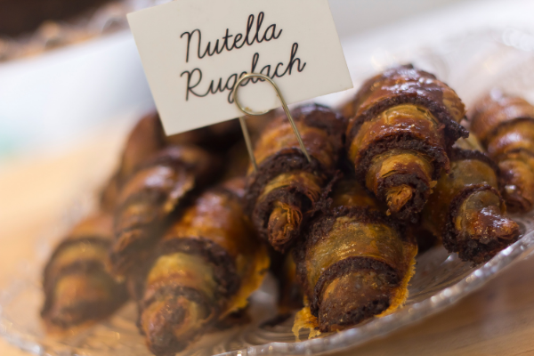 A stack the Israeli dessert, rugalah on a plate with the sign 'Nutella Rugalach'