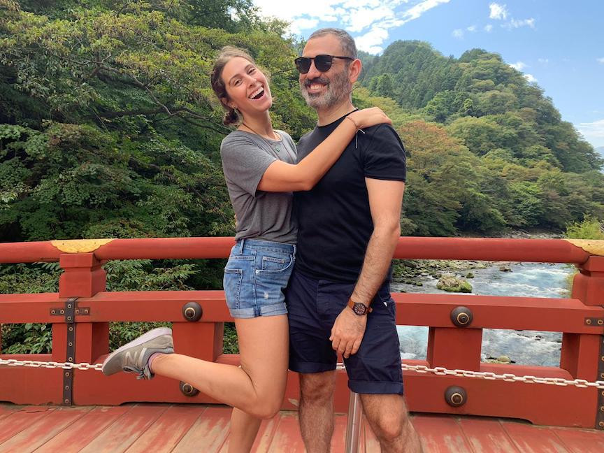 Olah Rachel Belsky holding onto her husband on a bridge