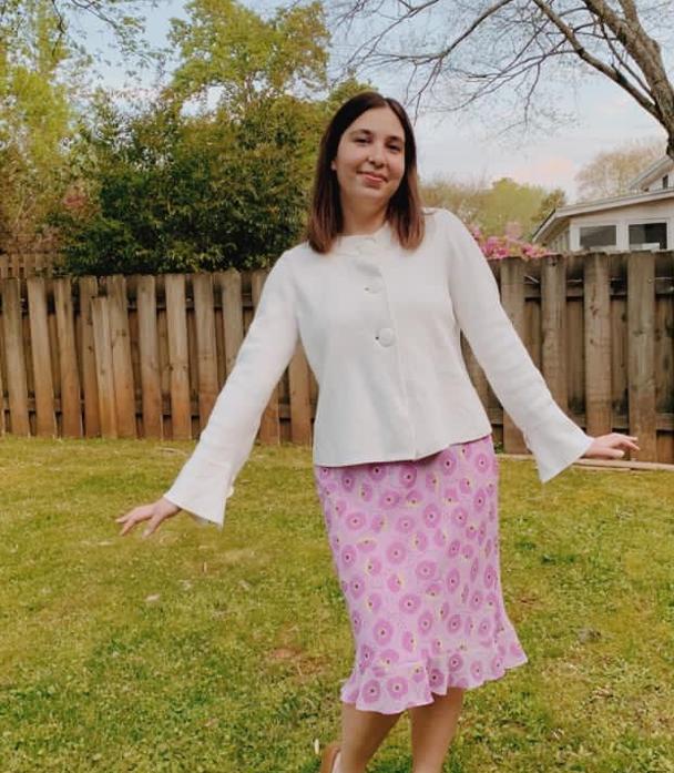 Olah Maia Dori standing in her backyard