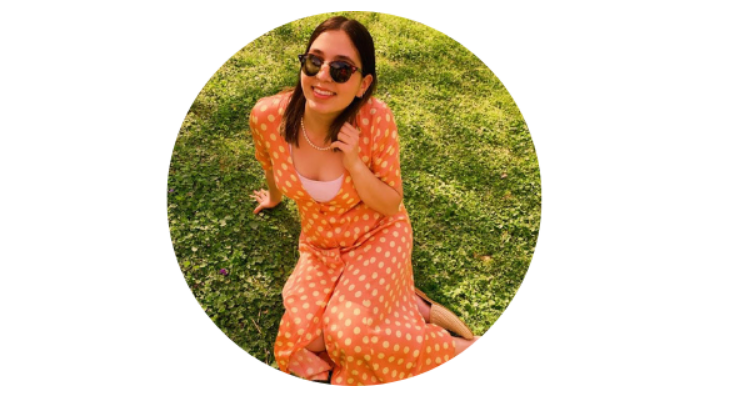 Olah Maia Dori laying on grass