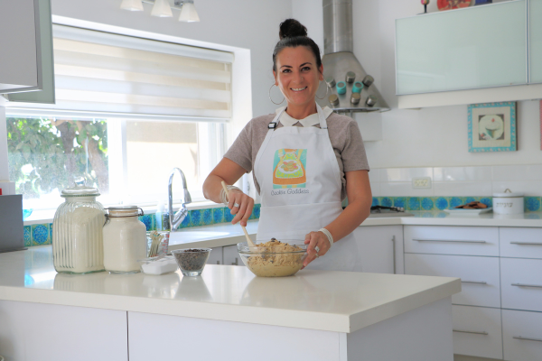 Elyse Shahar, owner of the Cookie Goodness, preparing cookie dough in her kitchen