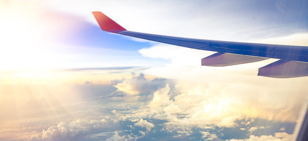 The wing of an airplane in the sky