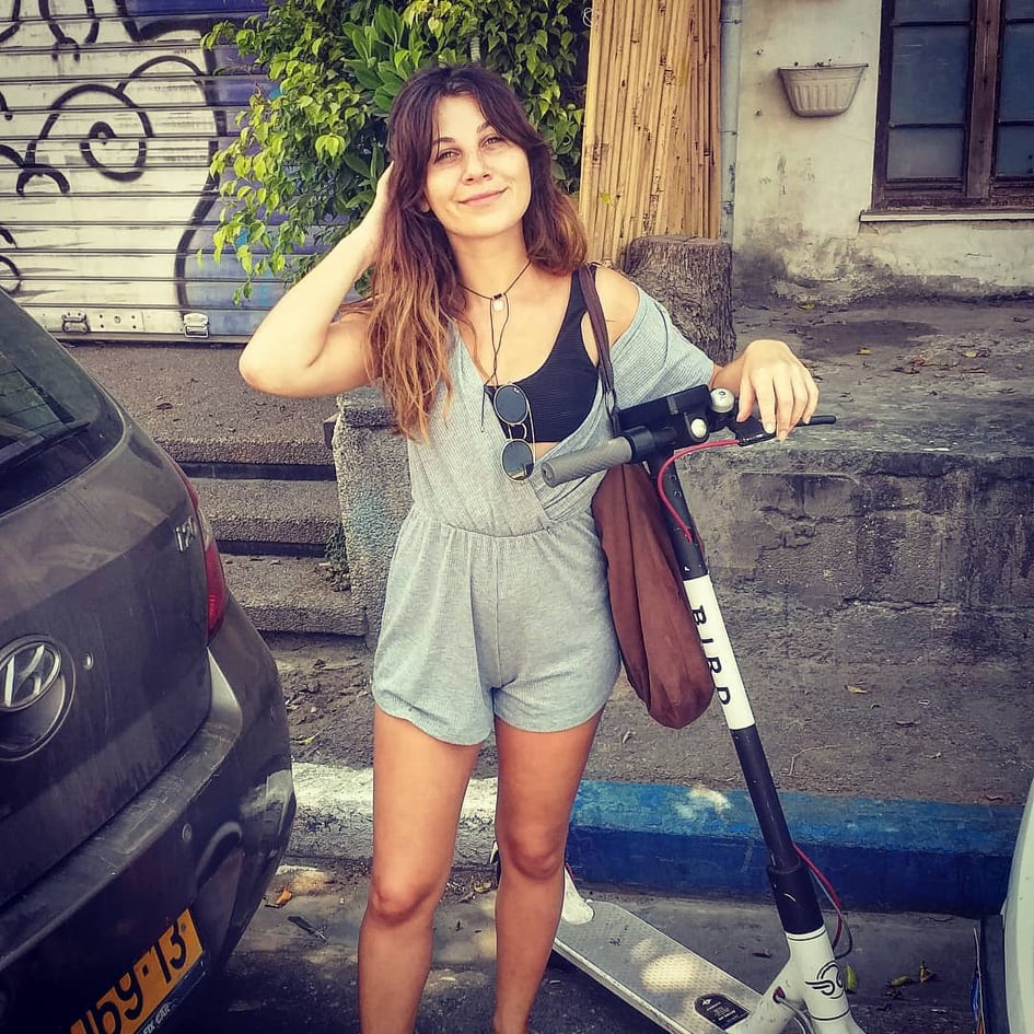Yaffa Abadi standing next to her electric scooter