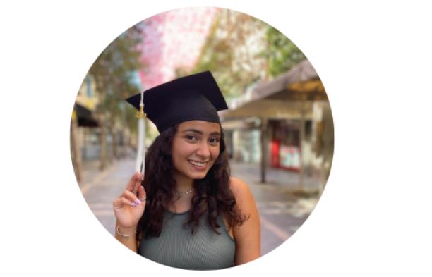 Olah Rosie Tourgeman wearing a graduation cap