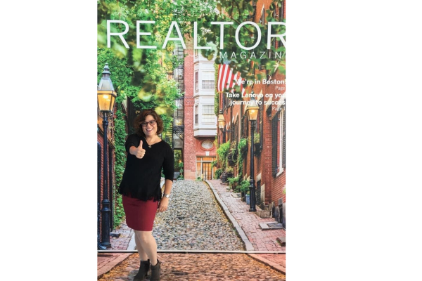 Jackie Bitensky on the cover of Realter Magazine giving a thiumbs up