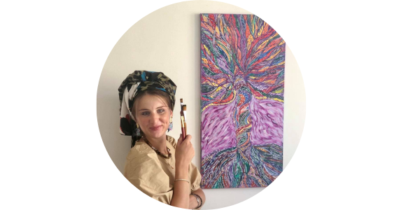 Ilana Altschuler Amiel standing next to one of her paintings